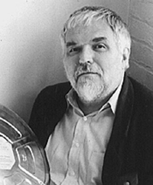 In the can: Stan Brakhage packs up.