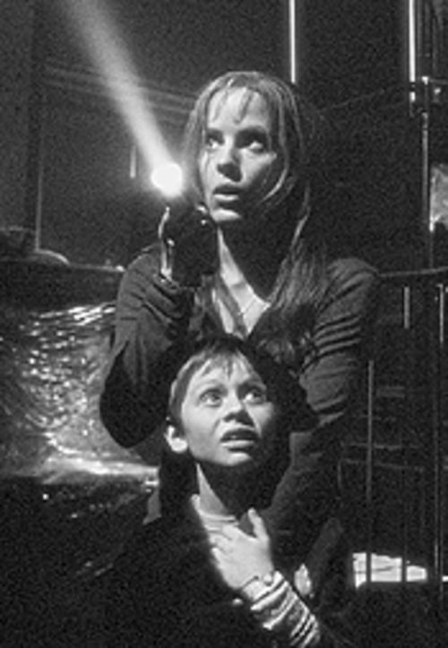 Emma Caulfield and Lee Cormie get spooked in Darkness Falls.