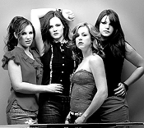Did somebody say pillow fight?: The Donnas boldly  brave bedhead.
