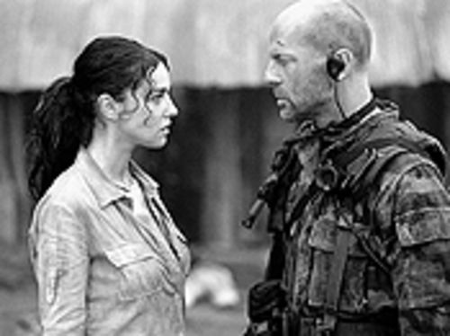 Signed and SEALed: Monica Bellucci and Bruce Willis  seek salvation in Tears of the Sun.