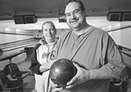 Spare time: Debbie and Robbie Moss are bowling for  dollars at Lakewood Lanes.