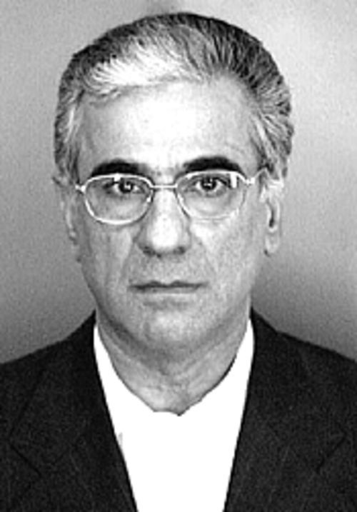 Would you buy a used condo from this man? Ali Patrik  Pahlavi's mug shot.