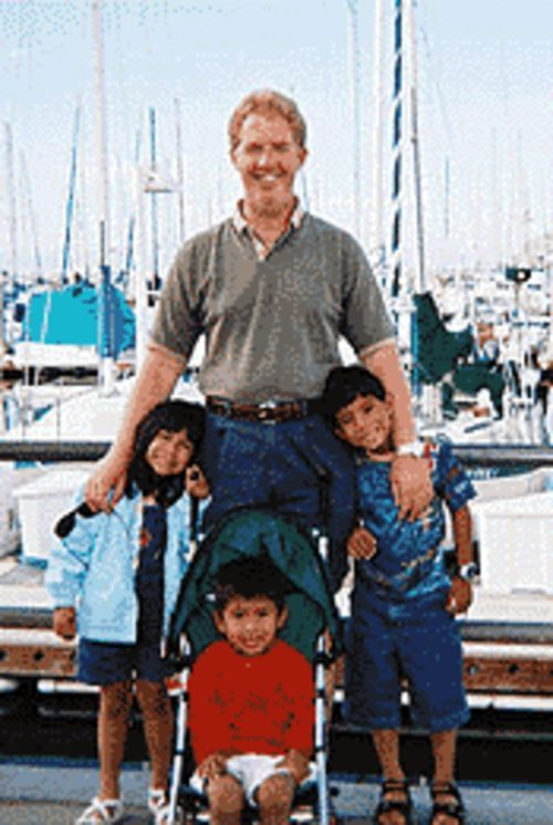 David Marin and his three foster children.