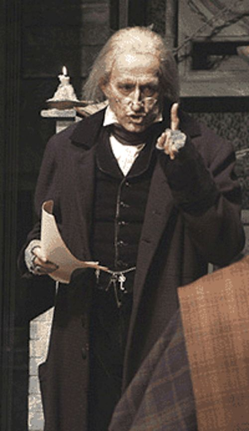 Randy Moore as Scrooge in A Christmas Carol .