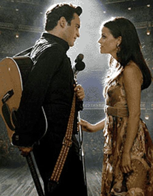 Joaquin Phoenix and Reese Witherspoon get ready to  pluck in Walk the Line.