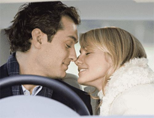 Jude Law and Cameron Diaz cuddle their way through a sappy Holiday romance.