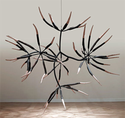 """Seven and Seven Flower,"" by James Surls, carved pine and painted steel."