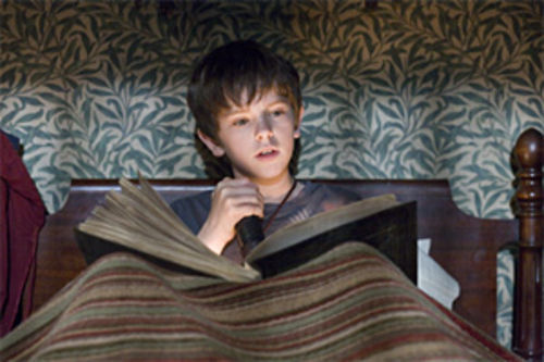 Jared Grace (Freddie Highmore) discovers a dangerous book in The Spiderwick Chronicles.