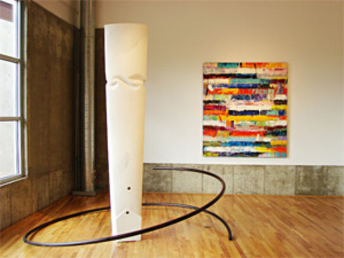 """Silencio"" (left), by Michael Clapper, marble and steel; ""Sisyphus Rocks,"" by Monroe Hodder, oil on canvas."