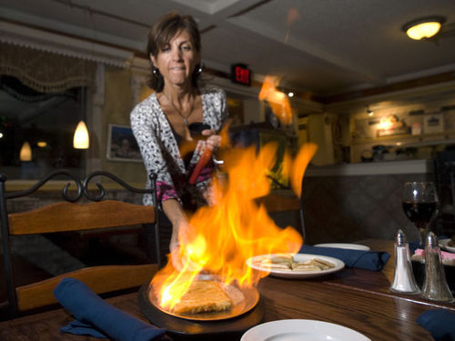 Angie Statnopoulos with Saganaki, or flaming cheese. See a full slideshow from The Athenian.