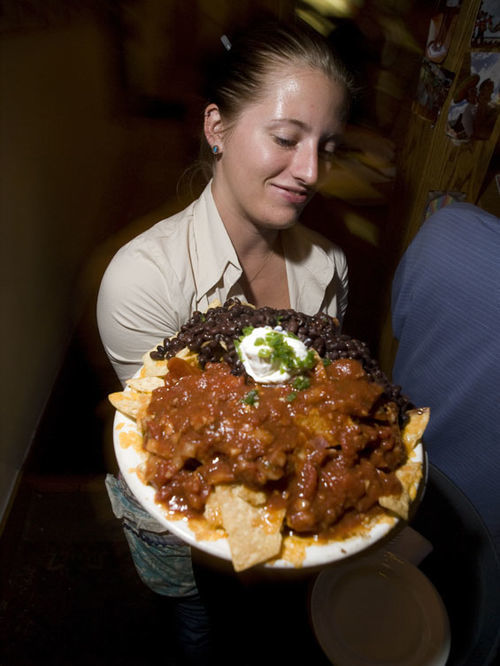 "Jessica ""Memphis"" Johnson serves nachos. View a full slideshow from Mountain Sun Pub & Brewery in Boulder."