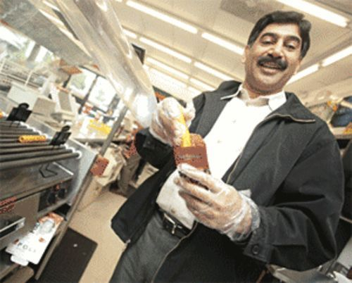 Rise and shine: Tariq Tariq at his 7-Eleven.