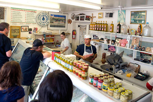 Tony Lonardo (in hat) meats the public at Carbone's Italian Sausage Deli.