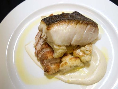 The Wooden Table's black cod on an earthy cauliflower purée. Slide show: In the kitchen at The Wooden Table.