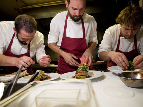 Ben Klein, Josh Rathburn and Johnny Courtney assemble plates at Fruition. Slide show: In the kitchen at Fruition