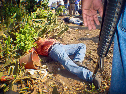A Veracruz crime scene. Slide show: Mexicans Pay in Blood For America's War on Drugs.
