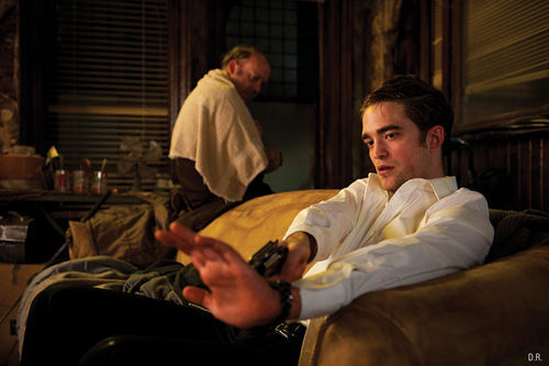 Paul Giamatti (left) and Robert Pattinson star in Cosmopolis.