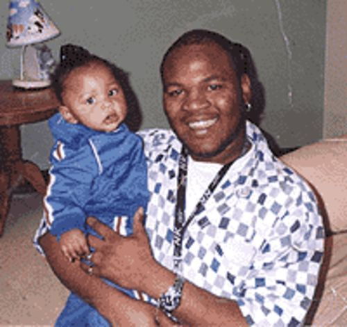 Ronelle Murrell with his youngest son.