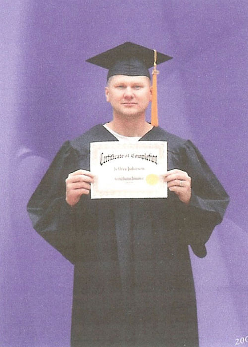 Johnson after receiving his GED certificate in prison in 2009.