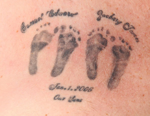 Jeremy Stodghill has a tattoo of his sons' footprints on his chest.