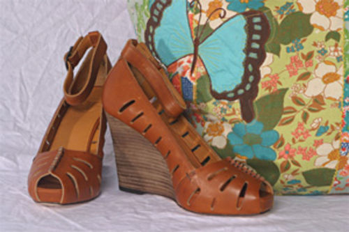 Get packing with a pair of Frye wedges and bright tote bag.