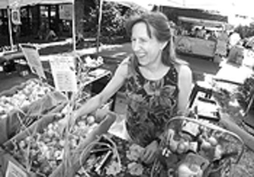 Odor eaters: Karen Beeman sells her garlic at the Boulder Farmers' Market.
