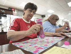 Players lay their cards on the table at Bingo City.