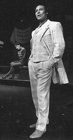 Joan Staples (background) and Daniel Guzman in Guys and Dolls.