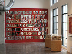 "Installation view of the Roland Bernier show, with ""Wall of Words"" in the background."