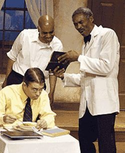Leonard E. Barrett Jr. and Earlie Thomas (standing,  from left) with Nathan Young in Master Harold and  the Boys.