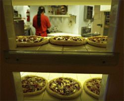 Global warming: Pizzeria Mundo serves up the world  on a pizza crust.