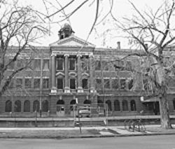 The Evans school in all its decay today. Tracy Rollert  fell from the second-floor ledge at the right.