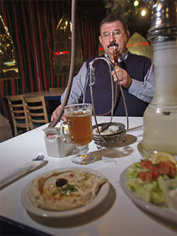 He'll hookah you up: Ahmad Alkiteb, owner of Aladdin Cafe and Grill.