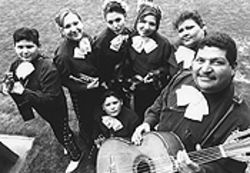 Blowing their horn: Raul and Sylvia Vasquez and their five mariachis.