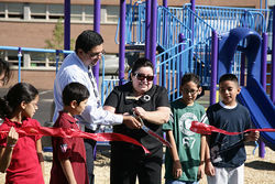 Andrea Merida cuts the ribbon on a new Learning Landscapes playground at Doull Elementary in southwest Denver.