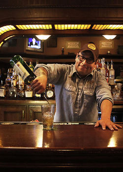 Jay Gonzales pours some more cheap, delicious drinks at Patrick Carroll's.