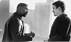 Ebony and ivory: Denzel Washington teaches Ethan Hawke a thing or two about police work and facial hair in Training Day.