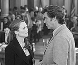 Oughtta be a law: Julianne Moore and Pierce Brosnan  face off in Laws of Attraction.