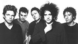 Incureable: Robert Smith (second from right) has  rediscovered his youthful vigor.