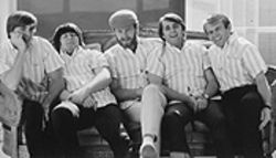 Brian Wilson then (second from left, sleeping) with the Beach Boys.