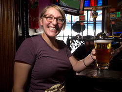 Lisa Holiga holds a pint of Strongbow, a strong argument for the British Bulldog. Slide show: Inside the British Bulldog
