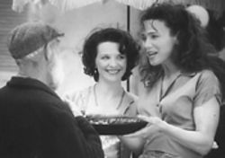 Juliette Binoche watches Lena Olin hand out treats in Chocolat.