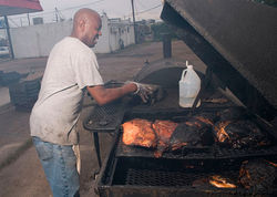 Lawrence Barkers keeps the home fires burning at Country Time BBQ. When I was finally capable of movement, I called Miller to thank him for his recommendation. It doesn't take a certificate in barbecue judging to recognize that the Barkerses make some exemplary 'cue.