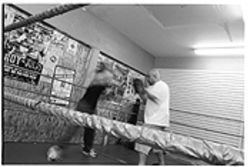 No train, no gain: Terri Cruz works out with coach/promoter/boyfriend Steve Mestas at the House of Pain.