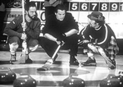 Canuck yuks: Paul Gross (center) shares a sweeping vision with his mates in Men With Brooms.