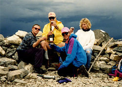 Don Becker (left) with Brent and Denise Johnson and an unidentified friend (foreground) on Grays Peak in 1992.