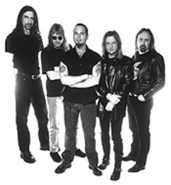 Tim Owens (center) took over vocal duties in Judas Priest after Rob Halford exited.