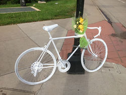 "A ""ghost bike"" memorial was erected at the corner of Speer and Lincoln Street for Dan Peterson."