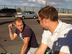 John Hayden (left) and Jonny Rotheran take a bike ride through Denver.