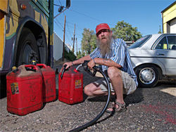 Bill Hill, of Tucson, fuels up at the Denver Biodiesel Cooperative.